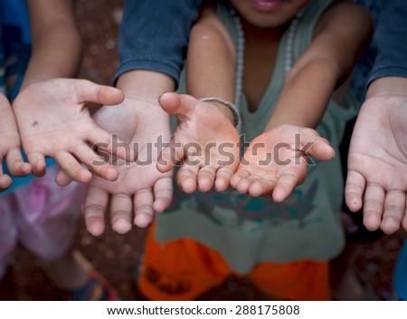Children Raising hands beg for some food. - stock photo