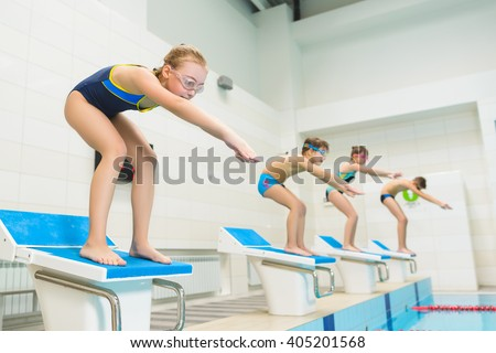 children ready to jump into sport swimming pool. Sporty kids - stock photo