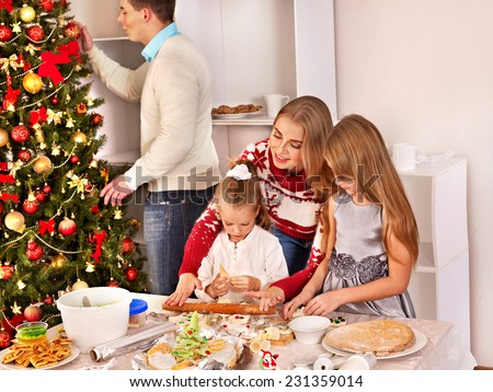 Children rolling dough in Xmas kitchen. - stock photo