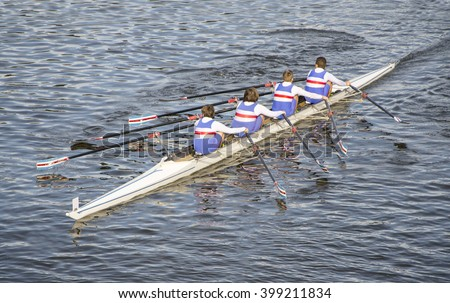 children rowing and training on a canoe on a beautiful lake in Italy - stock photo