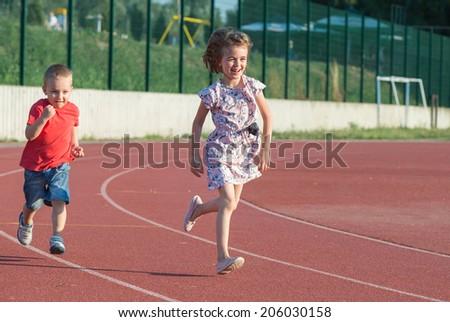children running on the track - stock photo