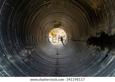 children running towards the light in the tunnel