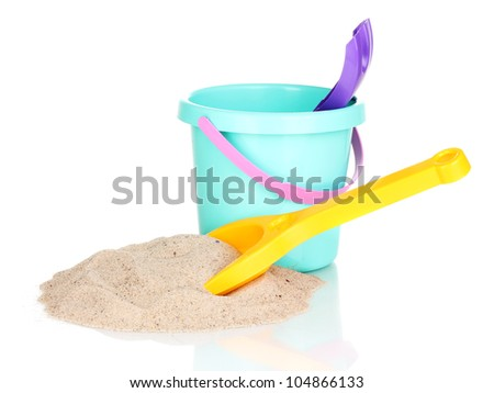 Children's beach toys and sand isolated on white