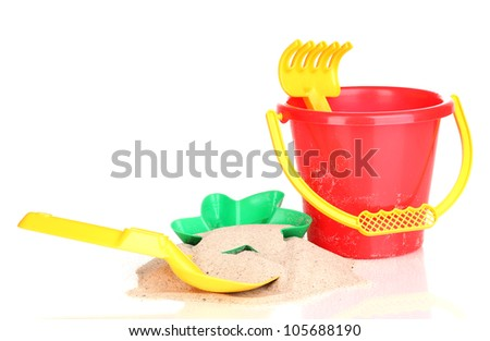 Children's beach toys and sand isolated on white - stock photo