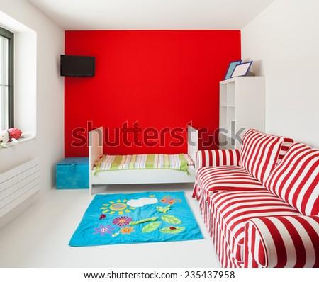 Children's bedroom in modern house - stock photo