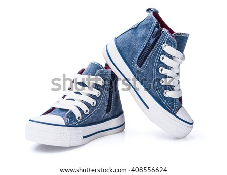 Children's blue jeans denim gumshoes isolated on white background - stock photo