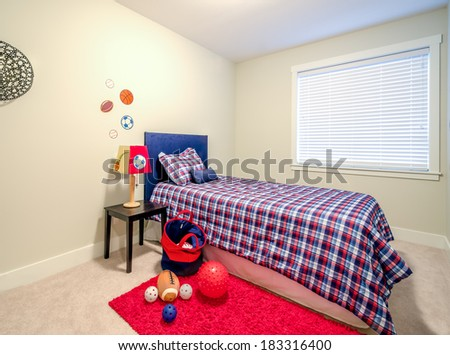 Children's boy's blue and red bedroom playroom. Interior design. - stock photo