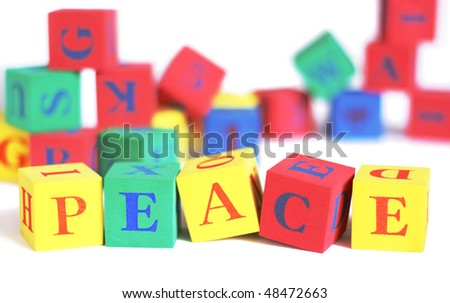 Children's building blocks spelling out the word 'peace'