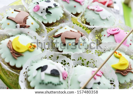Children's Cakes decorated with animal figures - stock photo