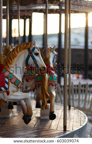 Children's carousel with horses outdoor