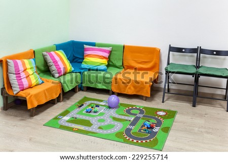 Children's corner in the large living room, simple interior - stock photo