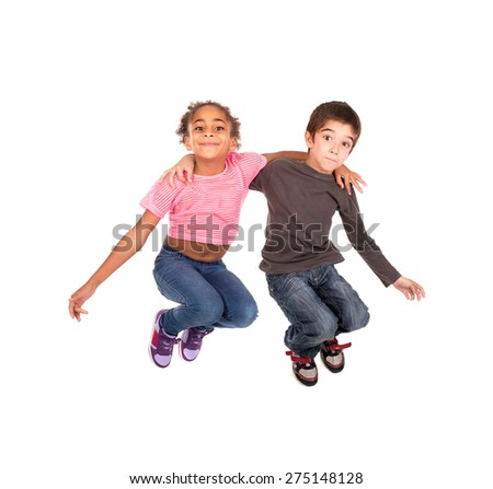 Children's couple jumping isolated in white - stock photo