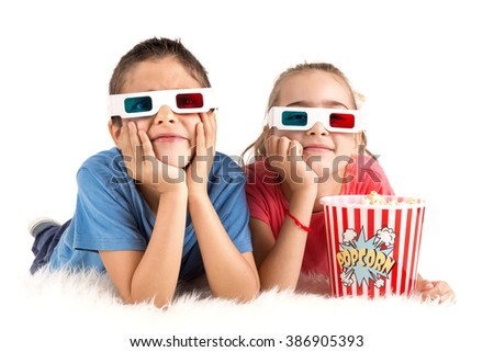 Children's couple with 3d glasses and popcorn