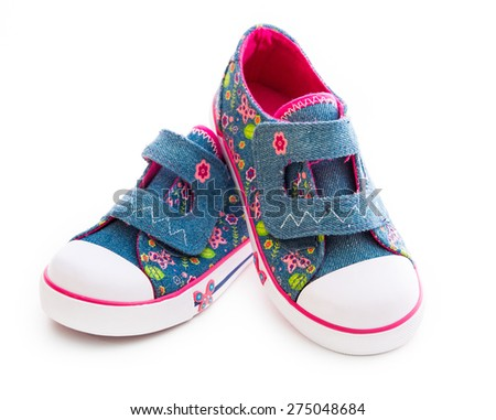 Children's denim shoes isolated on white background - stock photo