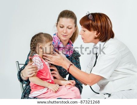 Children's doctor examines a child - stock photo
