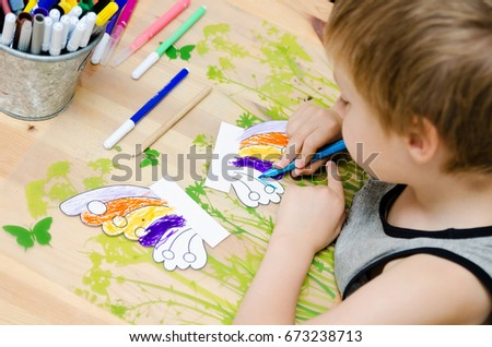 Children's drawing and painting in the house.