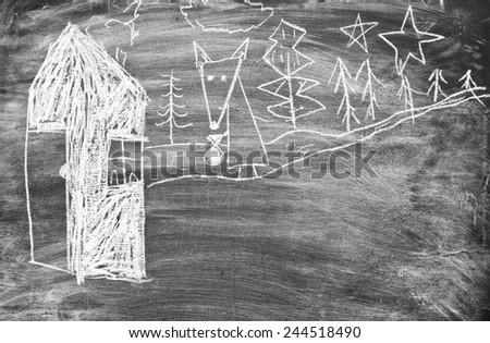 Children's drawing on a blackboard - stock photo