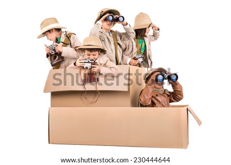 Children's group in a cardboard box playing safari - stock photo