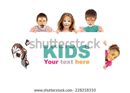 Children's group with face-paint over a white board - stock photo