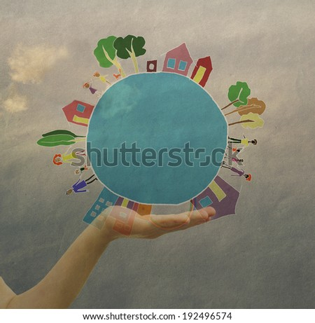 Children's hand holding a globe,, vintage, feeling of peace of the world, security, friendship - stock photo