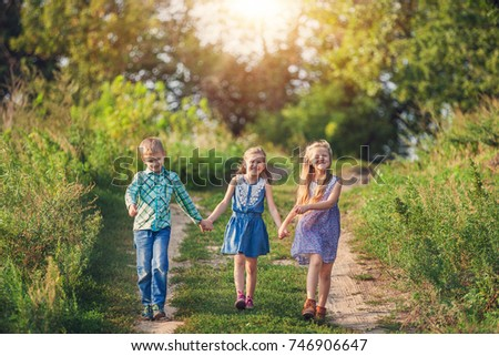 Children's having fun and happy time in green forest