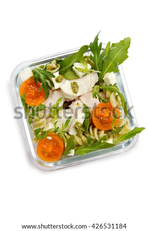 Children's lunch box: boneless walleye with pasta, arugula, tomatoes and pesto salad - stock photo