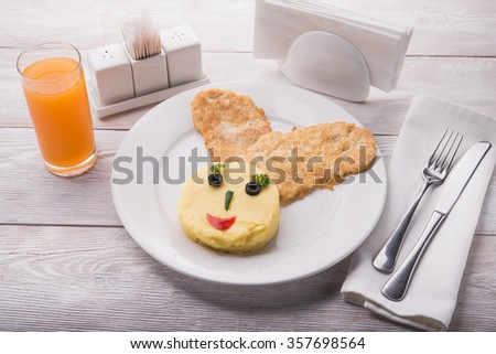 children's menu. mashed potatoes and chicken meat on white plate - stock photo