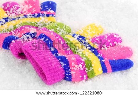 Children's mittens in snow - stock photo