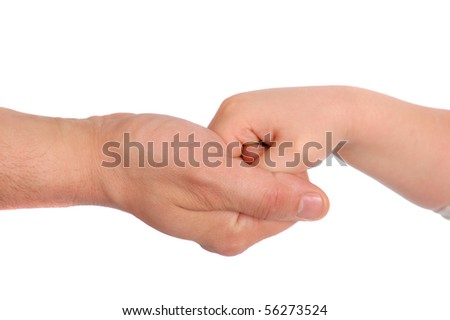Children's palms in a reliable man's hand