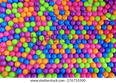 Children's party, a games room, a box filled with small plastic colored balls. View from above  - stock photo