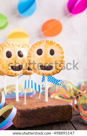 Children's party background. Homemade shortbread cookies on stick called pie pops.