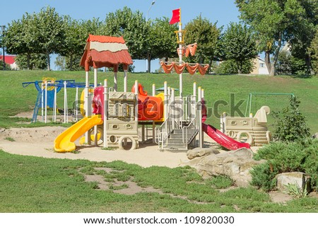 Children's playground in the park on a bright sunny day