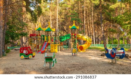 Children's playground with slides and swings in the park