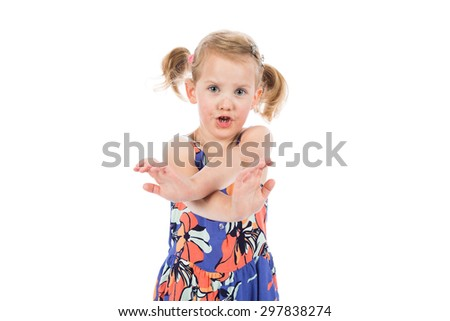 Children's real emotions. Portrait of a little girl making stop gesture on white background. - stock photo
