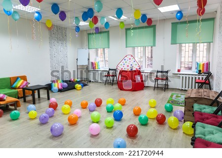 Children's room decorated with balloons ready for the holiday, nobody - stock photo