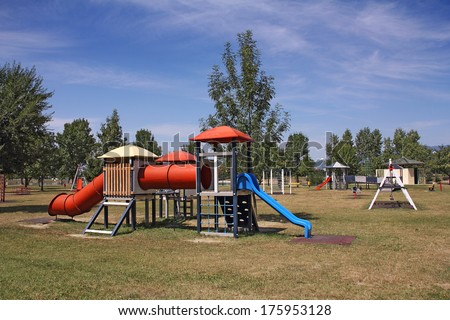 Children's school playground with swings and slide the blue - stock photo