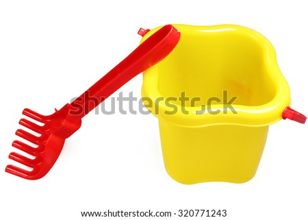 Children's set - a plastic bucket and a rake on a white background