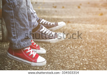 Children's shoes. Red vintage sneakers. - stock photo