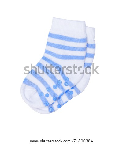 Children's socks with a rubber sole that the child didn't slide on a floor - stock photo