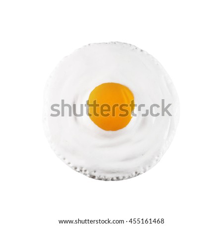Children's toy a plastic, fried eggs isolated on white