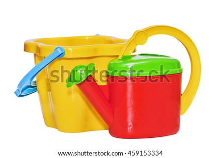 Children's toy, bucket and watering can for a sandbox isolated on white