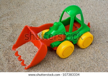Children's toy: bulldozer in sand