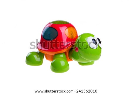 children's toy green turtle isolated on white background - stock photo