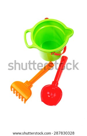Children's toys  bucket  shovel and  rake on the white - stock photo