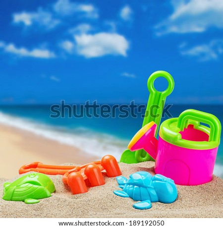 children's toys in the sand on the beach