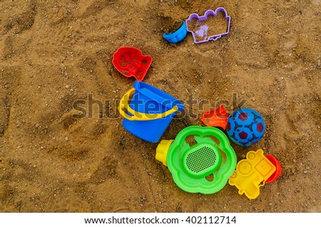 children's toys in the sandbox, shallow DOF