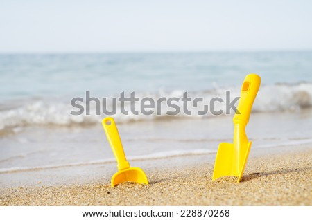 Children's toys on a sea beach.Summer holiday on a resort. - stock photo
