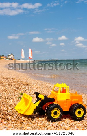 children's toys on the beach a sunny day - stock photo