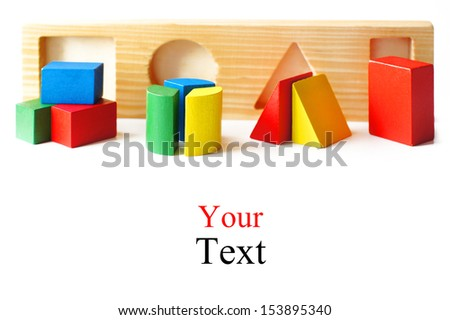 children's wooden blocks. isolated on a white background. space for text. shallow depth of field - stock photo