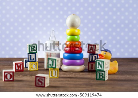 Children's World toy on a wooden background. Studio shot]